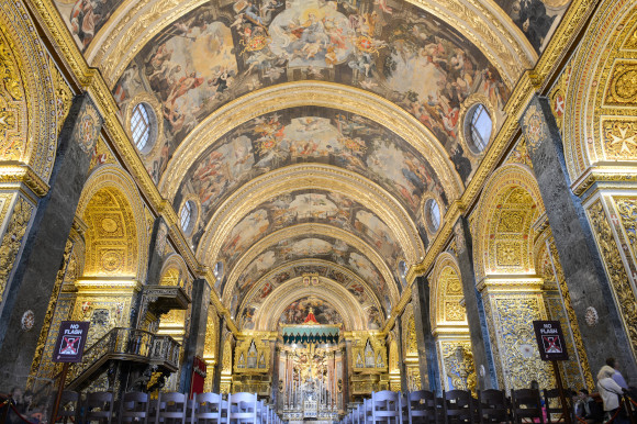 The domed art-work filled ceiling and walls of St John's Co-Cathedral in Malta Valletta