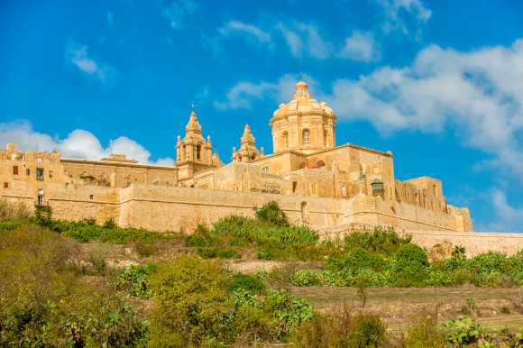 The architectural wonder of St Paul's Cathedral standing proudly on the hilltop in Mdina Malta