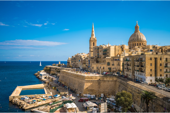 The striking Valletta Waterfront surrounded by shimmering azure waters, Malta
