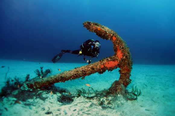 Diver studying the anchor next to Tug Boat Rozi wreck site in Cirkewwa