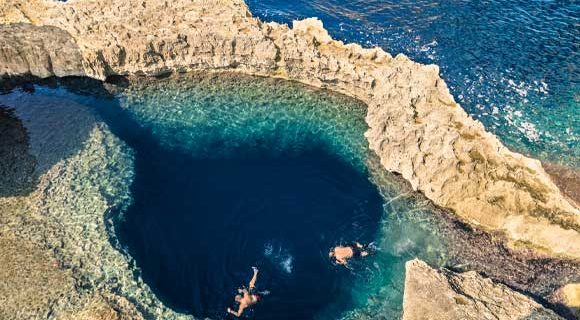Overhead view of divers at the Blue Hole in Dwejra, Gozo