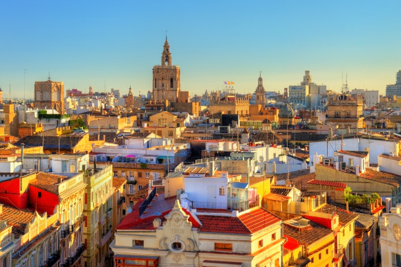 A view of the sun shining over Valencia's beautiful buildings in Spain