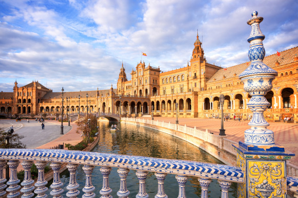 Plaza de Espana in Seville surrounded by glistening water and ornate bridges