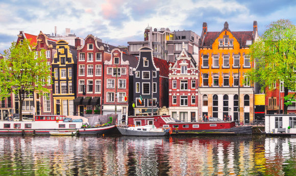 Amsterdam's beautiful coloured town houses overlooking its tranquil canal