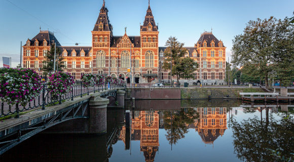 The Museum Quarter in Amsterdam and canals and State Museum at dusk