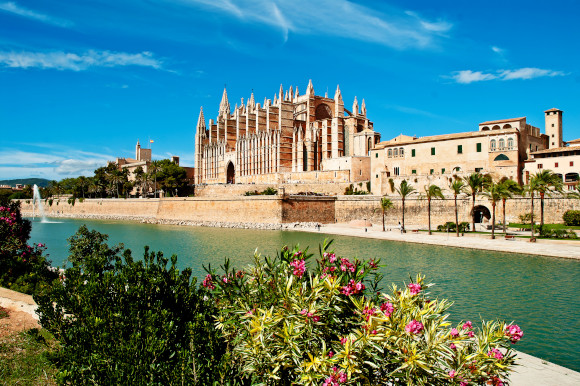 A beautiful view of the famous Cathedral of Palma de Majorca surrounded by water