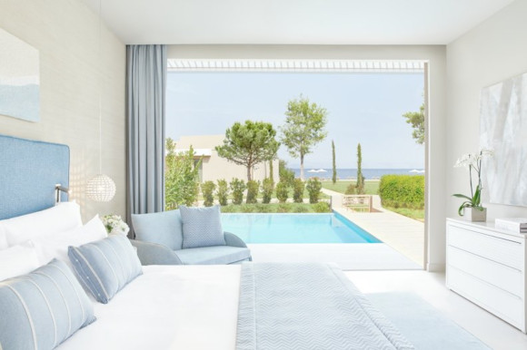 Featuring the bed and swim-up suite in the deluxe rooms at Ikos Dassia Greece