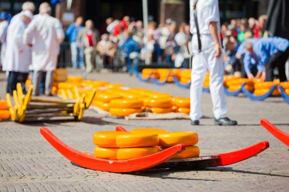 Cheese waiting to be transported in Alkmaar Waagplein
