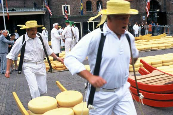 Cheese carriers on market day carrying cheese on a stretcher