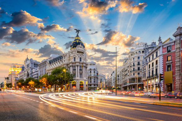 A view of Calle de Alcala and Gran Via in Madrid surrounded by blue skies