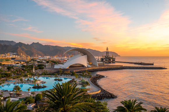 Santa Cruz in Tenerife at sunset with a backdrop of mountains and sea