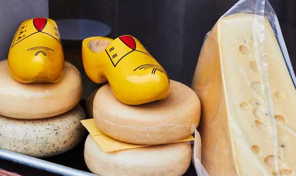 Two traditional Dutch products in a shop window - Clogs and Cheese