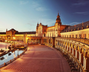 Plaza de Espana lit up at night in the Spanish city of Seville