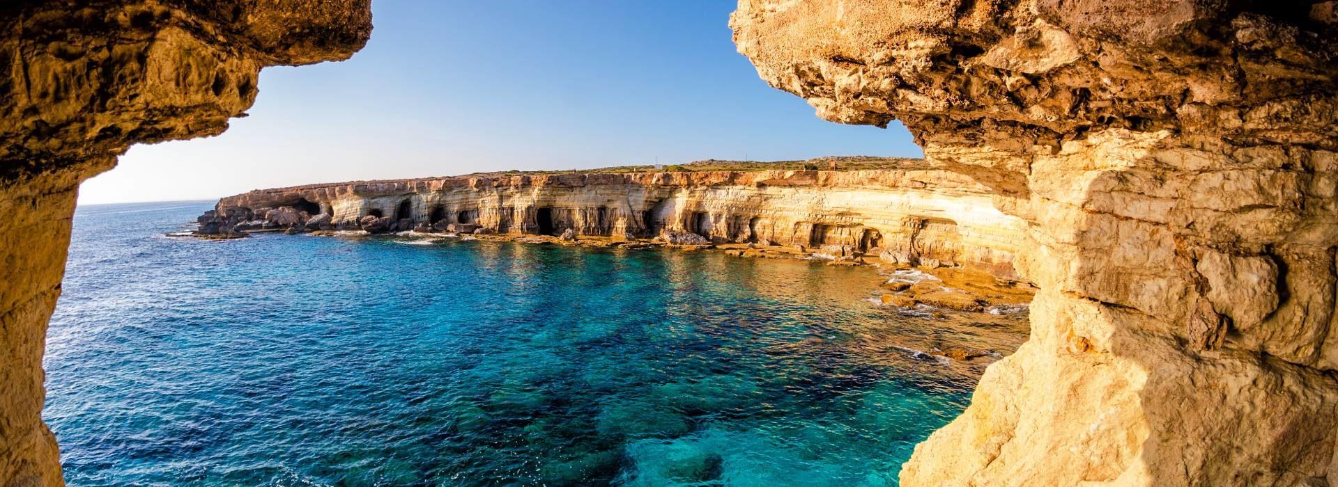 The ocean through rocks in Portugal