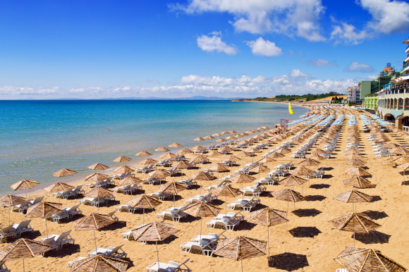 A golden beach scattered with sunloungers in Nessebar, Bulgaria