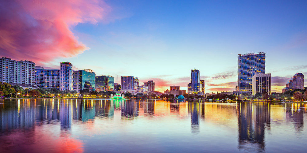 Orlando's Downtown skyline with tall buildings surrounding Eola Lake