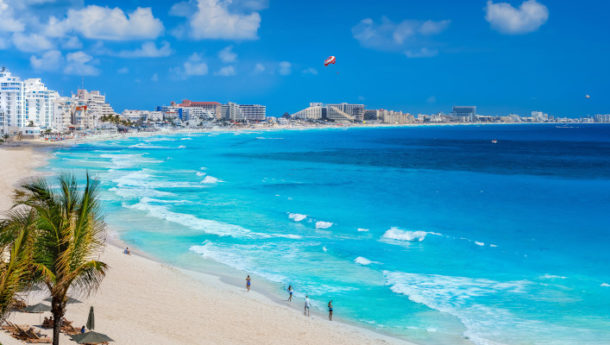 Cancun's skyline overlooking the glistening Caribbean sea with hotel's fronted by the whitest sands