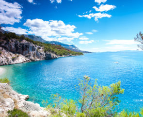 Stunning view of landscape with beautiful Adriatic Sea and quiet majestic bay in Dalmatia, Croatia, Europe. Summertime multicolored vibrant outdoors horizontal image with blue sky background.