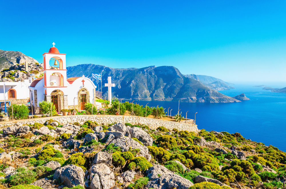 Amazing sea bay on Greek Island with Greek white church