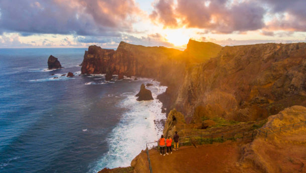 People sunset viewing from a Madeira viewpoint