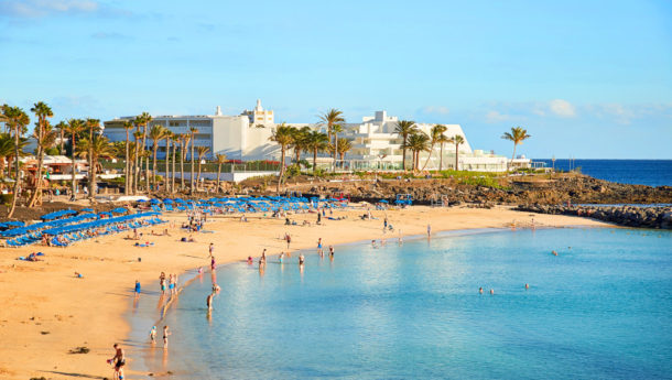 A beautiful golden sand beach in the resort of Playa Blanca on the island of Lanzarote