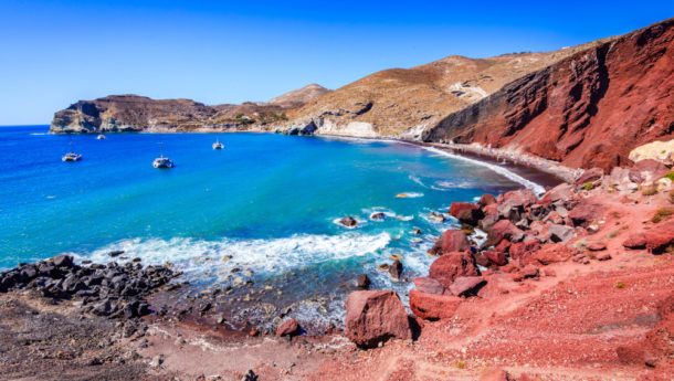 Santorini, Greece. Red Beach is one of the most beautiful and famous beaches of Thira island, Aegean Sea, Cyclades.