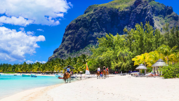 Le Morne Beach in Mauritius backed by incredible scenery with lengthy white sands