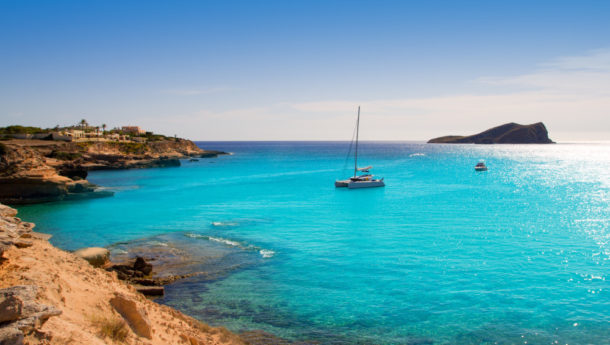 The azure sea with a boat in the water in San Antonio in Ibiza