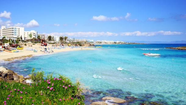 A beautiful view of Fig Tree Bay in Protaras, Cyprus with golden sand and azure waters
